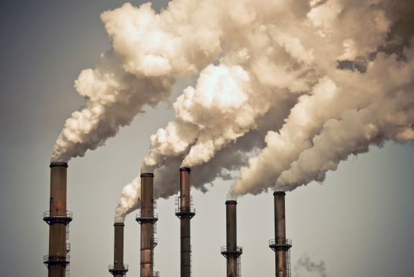 polluted air rising out of factory towers