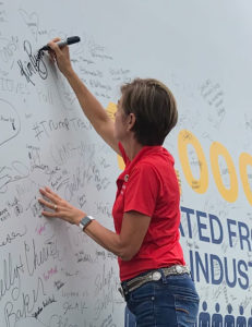 Governor Reynolds signs wind turbine blade for wind week