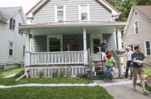 olunteers clear off a porch that is slated to be replaced during Matthew 25's Transform Week in Cedar Rapids on Wednesday, June