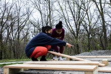 Aluna-Aro Olaniyi (left) and Cherish Cornett (right) discuss how to lay out the boards for the design of the boxes on Sunday, Ap