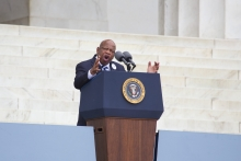 John Lewis speaking at a podium
