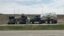 semi rolled over off side of road causing fertilizer spill