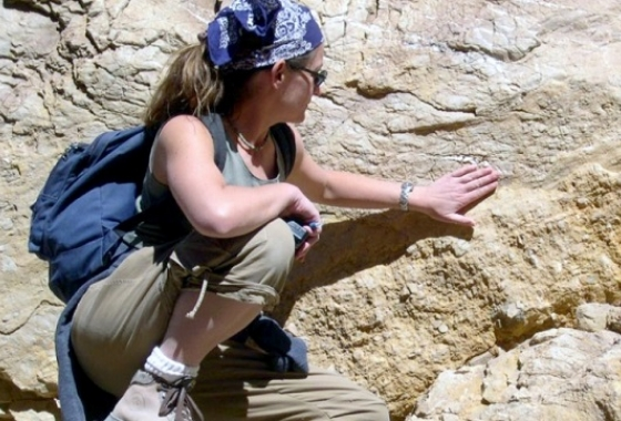student at rock formation