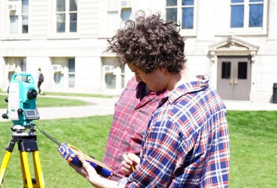 geography student using survey technology in pentacrest