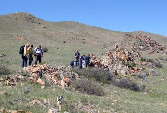 students on hike with rock formations