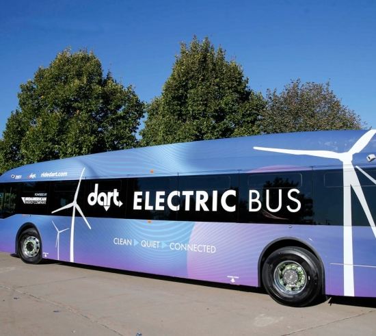 bus with logo, dart Electric Bus, sitting in parking lot