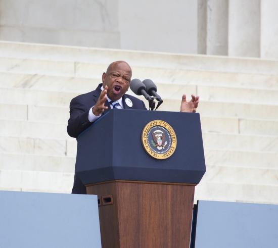 John Lewis speaking at a podium