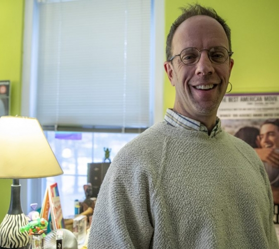Barry Schreier standing in a his office at the West Lawn Building