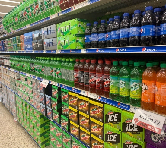 grocery store aisle of pop