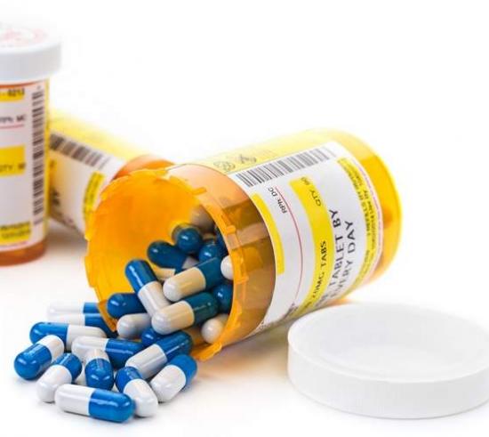 prescription pills falling out of bottle